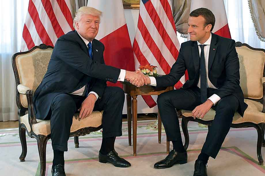 Firm grip… Trump was piqued by losing  handshake showdown with new French president Emmanuel Macron in the week before he pulled the US out of Paris deal (pic:Mandel Ngan/AFP/Getty Images)
