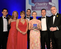 HSBC receive their award from BBC News presenter Huw Edwards [r]